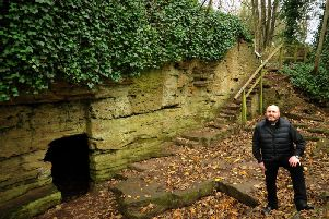 The Rev Garry Hinchliffe of St John's Church outside St Roberts Cave in  Knaresborough.