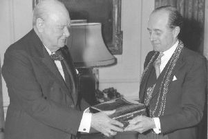 1944 - Sir Winston Churchill, British Prime Minister, receives a special cigar box from Ogdens Jewellers of Harrogate.
