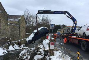 Cars being winched out of the hole. Photo: Environment Agency