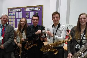 Rossett School Saxophone Quartet  with their adjudicator Malcolm Green