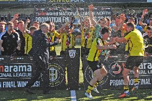 Champagne is sprayed around as Harrogate Town hoist the National League North play-off trophy and get their promotion party underway (Picture: Tony Johnson).