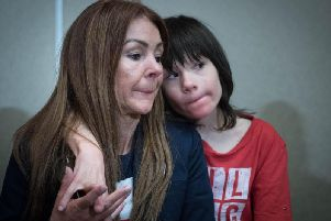 Billy Cauldwell with his mother Charlotte. The severely epileptic child who had his cannabis medicine confiscated by the Home Office will remain in hospital after a string of life-threatening seizures. Photo: PA