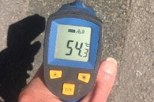 The thermometer reading shows just how hot the ground is