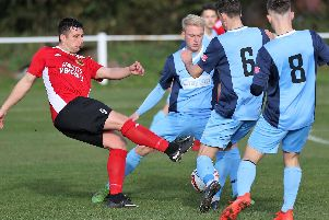 Knaresborough Town striker Paul Beesley's route to goal is blocked by a wall of Bottesford players. Picture: Craig Dinsdale
