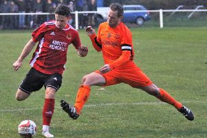 Knaresborough Town's Dan Thirkell is challenged by a Penistone man. Picture: Craig Dinsdale