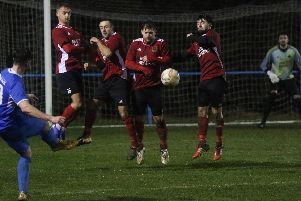 Knaresborough Town defend a free-kick during Saturday's win at Hemsworth. Picture: Craig Dinsdale