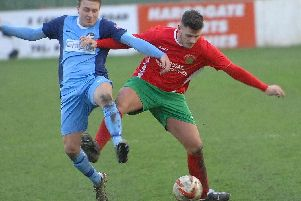 Harrogate Railway's Josh Underwood battles for possession during Saturday's draw with Bottesford. Picture: Adrian Murray