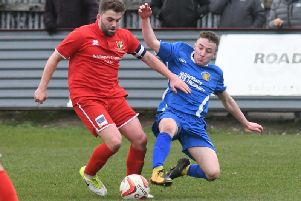 Harrogate Railway's Sam Barker challenges Bridlington Town skipper Andy Norfolk during Saturday's clash at Queensgate. Picture: Dom Taylor