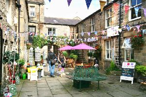 Pateley's Kings Court, brimming with flowers and bunting.