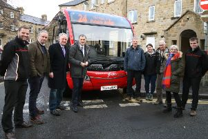 Julian Smith MP and various Pateley residents with members of the bus company and the National Trust.