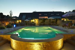 The outdoor pool lit up at night