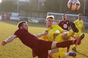 Knaresborough Town's Rob Worrall flies into a challenge during Saturday's loss at Worksop Town. Picture: Craig Dinsdale