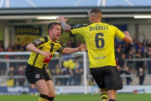 Josh Falkingham celebrates Harrogate Town's goal against AFC Fylde with Warren Burrell. Picture: Matt Kirkham