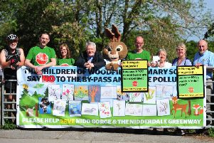 Harrogate and Knaresborough Andrew Jones MP, centre, with some of the protesters against a relief road in the Nidd Gorge.  (Picture: Gerard Binks)
