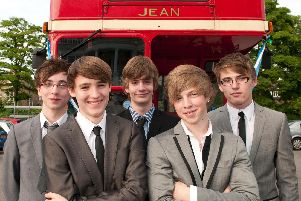 A group of Y11 boys enjoying the St John Fisher Catholic High School 2010 prom after rocking up in a vintage bus