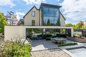 The rear of the house has been remodelled and extended. The glazing floods the house with natural light.
