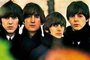 The Beatles pictured on the cover of their 1964 album Beatles for Sale.