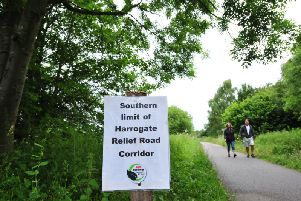 Signs of controversy - One of the Harrogate sustainable transport campaign group's banners against a 'Nidd Gorge relief road'.