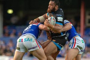 Suaia Matagi is held by Wakefields Jacob Miller and George King.'Wakefield Trinity v Huddersfield Giants.  BetFred SuperLeague.  Belle Vue Stadium.'28 June  2019.'Picture Bruce Rollinson
