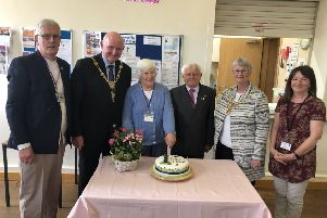 Friends of the cafe Bob and Linda, Mayor Councillor Stuart Martin and his wife April, and volunteers Norman Smales and Karen Tennant.