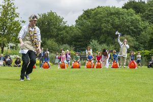 Children take part in a space hopper race on Yorkshire Day in summer at RHS Garden Harlow Carr.