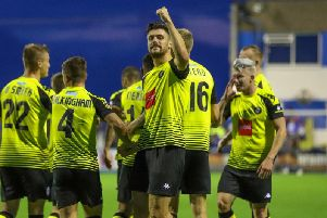 Connor Hall enjoys the moment in front of Harrogate Town's travelling supporters after scoring his side's third goal at Barrow. Picture: Matt Kirkham