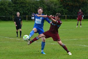 Josh Barden, left, challenges for the ball during Kirk Deighton Rangers' opening-day loss to Featherstone Colliery. Picture: Peter Arnett (KDRFC Media)
