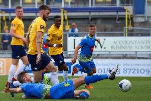 Jon Stead slides in to net his second goal against Torquay United, shortly before he was sent off for a second bookable offence. Picture: Matt Kirkham
