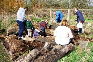Youngsters and their parents enjoying an outdoor activity at Summerhill Country Park and Visitor Centre.