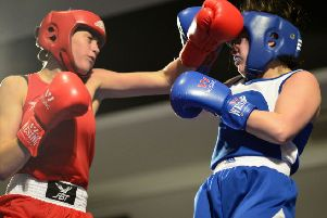 Danielle Marshall(red) in action against Charlie Horgan of Ryston Boxing Club, Ireland.