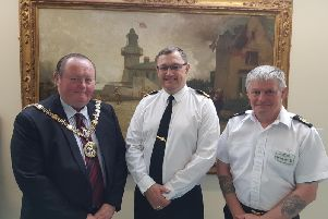 From left to right, Coun Barclay welcomes Commodore Waterhouse and Warrant Officer 1 Miller to the Mayors Parlour.