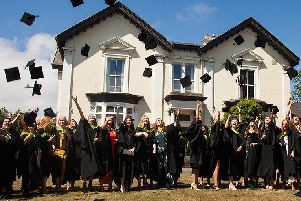 CCAD students celebrate their graduation with a traditional hat throw.
