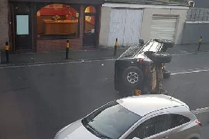A car was left flipped on its side.