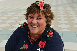 Sian Cameron with Poppies in Middleton Grange Shopping Centre.