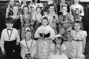 Some members of the Stage Door Theatre School with trophies in 1995.