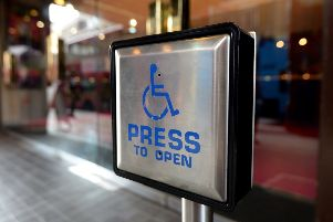 A disabled entrance door button. Picture by PA Wire/PA Images