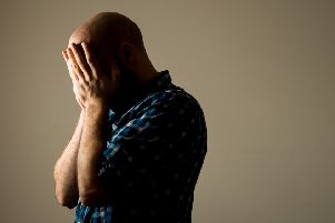 A man showing signs of depression (picture posed by model). Picture by PA Archive/PA Images