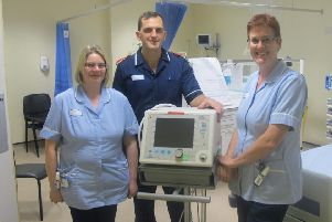 Left to right, staff nurse Emma Mitchell, Tom Bingham and staff nurse Sarah Hoggarth with the ventilator.