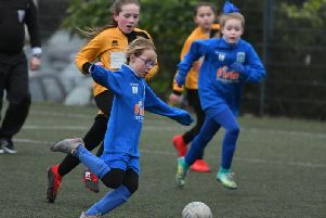 Hartlepool Pools Youth u9s,in blue, take on Norton & Stockton Girls u9s, in yellow, at Peterlee's East Durham College.