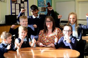 Kingsley primary headteacher Alison Darby holding a copy of their Ofsted report, with happy pupils (standing left to right) Jay Henderson, Civadhanu Kesavan and Millie Barrass (sitting left to right) Zach Gower, Isla Carruthers and Harriet Appleby.