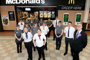 Jasper Maudsley (right) with staff outside of the refurbished McDonald's inside of Middleton Grange Shopping Centre. Picture by Frank Reid.