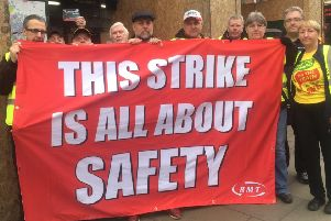 RMT members stage a protest.