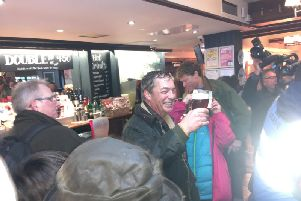 Nigel Farage toasts the first day of the protest at the Merry Go Round pub.