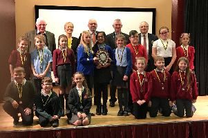 Youngsters from the five schools who took part in the Public Speaking Competition are pictured with the judges.
