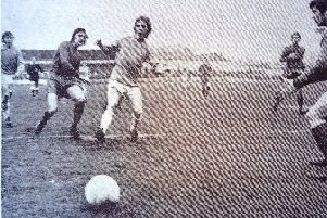 Ken Ellis goes on the attack at a Victoria Ground match watched by more than 6,000 fans.