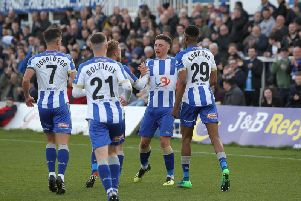 Hartlepool United's players celebrate after Josh Hawkes nets from the spot (Shutterpress).