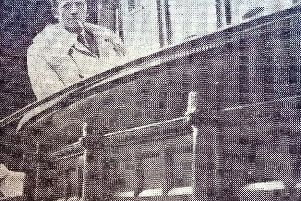 Hartlepool antique dealer Bruce Youle with the bar from the Shades Hotel which looked destined to head to America.