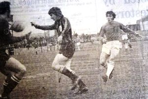 Ron Young goes close when he tries to meet a cross despite the attentions of the Bounremouth defence.