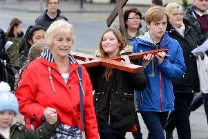 A cross is carried along Victoria Road to attend last year's Walk of Witness service held in Victory Square. Picture by Frank Reid