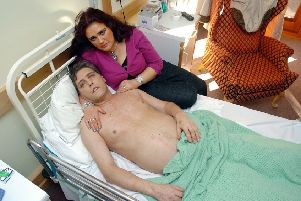 Carol Grayson with husband Peter in hospital in 2005.